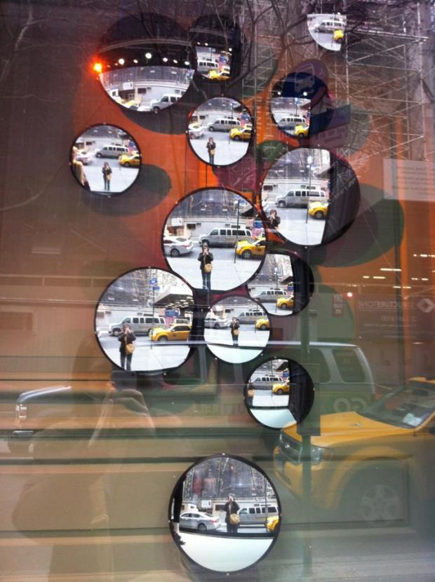 NYC reflected in round mirrors